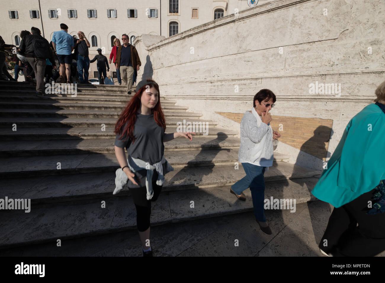 Rome Trinita de Monti, tourists walking down Spanish  steps. - Stock Image
