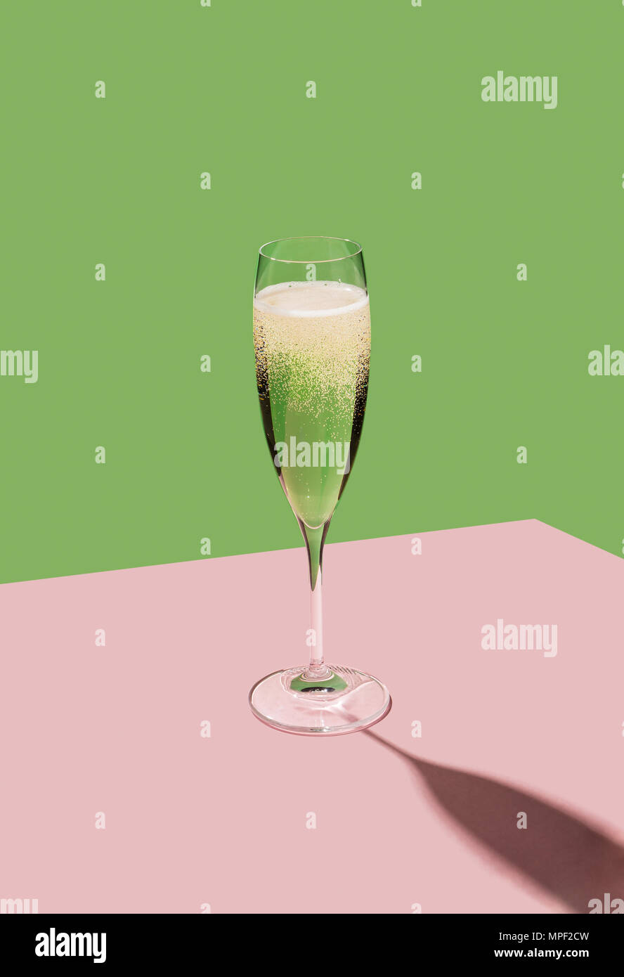 A flute filled with Prosecco, an italian white sparkling wine cultivated in Valdobbiadene. Pop colorful background Stock Photo