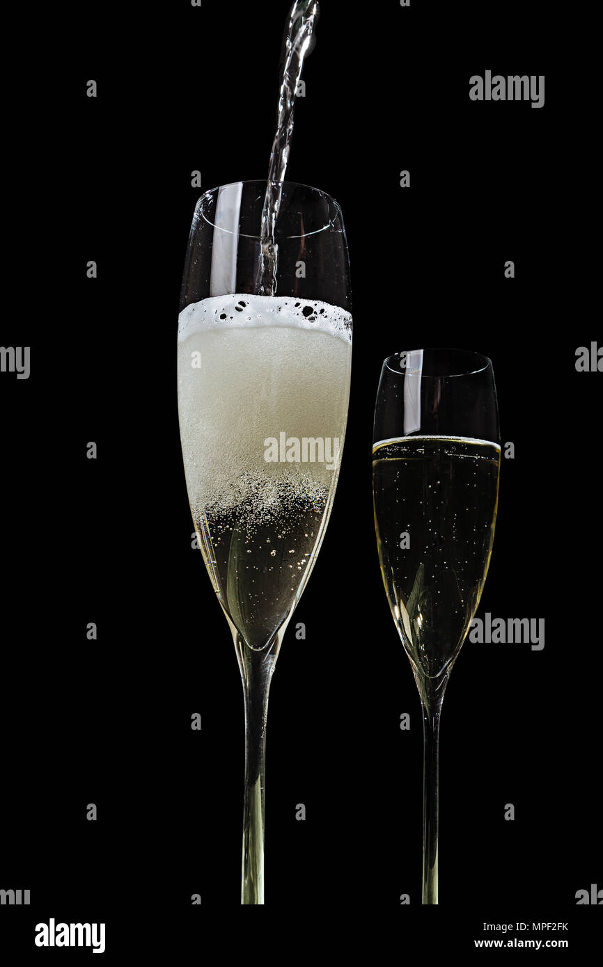 A flute filled with Prosecco, an italian white sparkling wine cultivated in Valdobbiadene. Pop colorful background - Stock Image