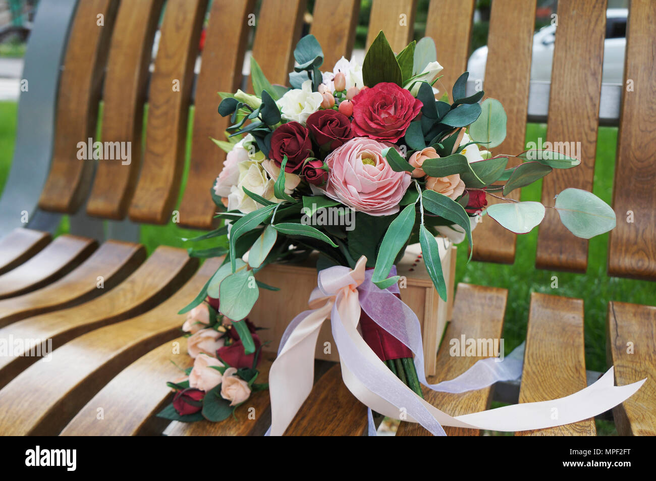 Artificial flowers made from sponge rubber. Bouquet for the bride. Foam-iran. Beautiful colorful wedding bouquet. Handmade flower fabric foamiran. - Stock Image