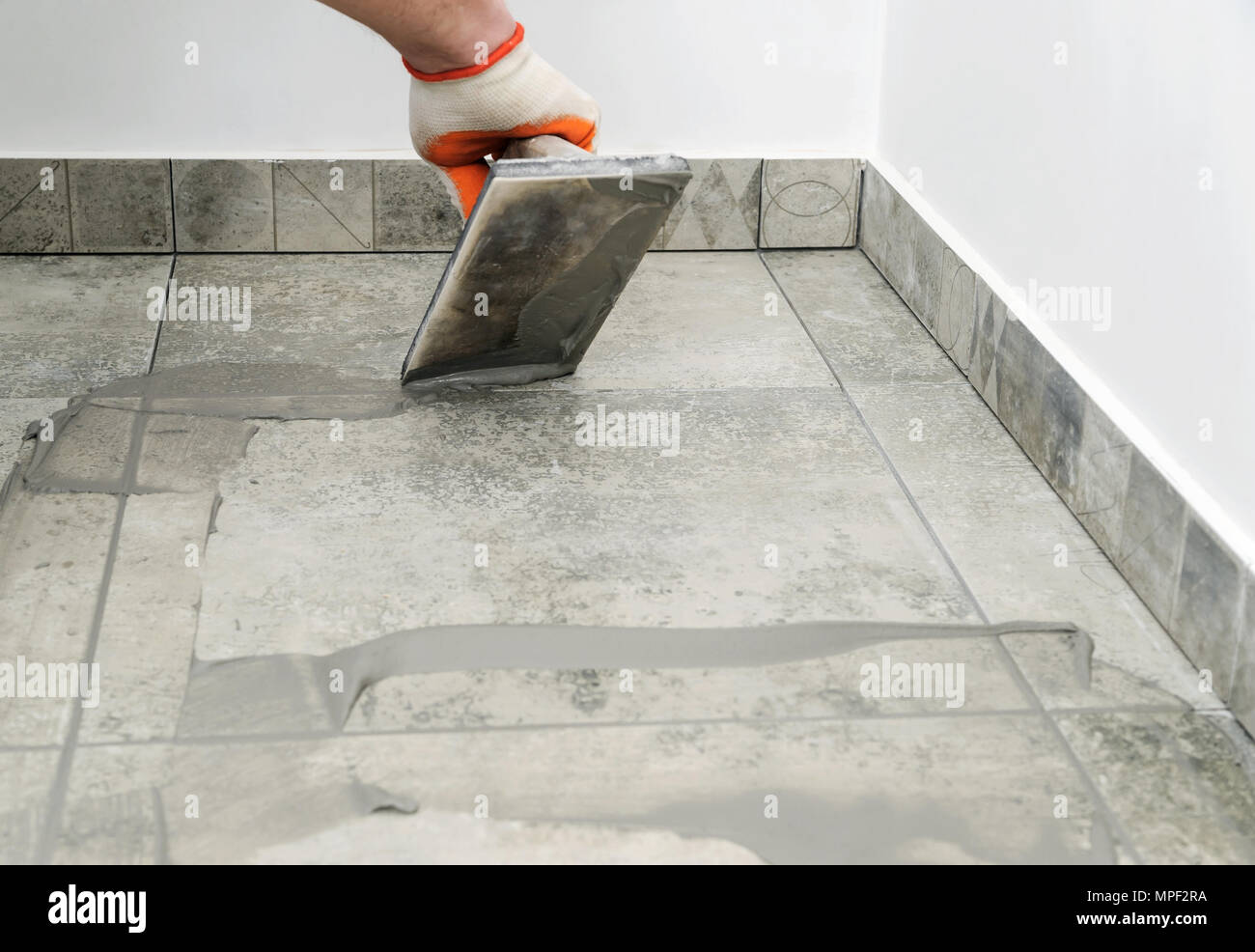 Grouting Ceramic Tiles Tilers Filling The Space Between Tiles Using