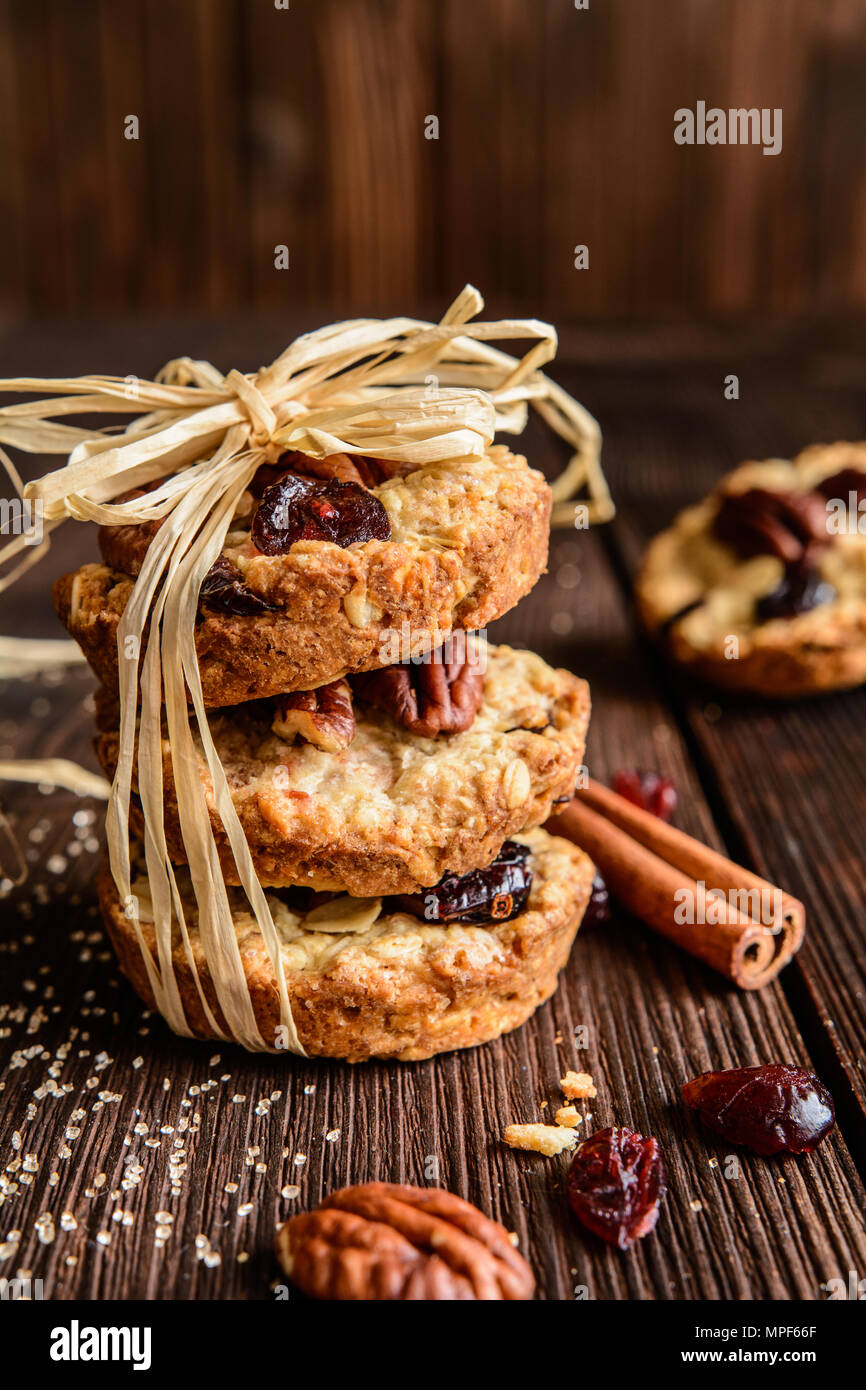 Homemade whole wheat oatmeal cookies with pecan nuts, dried cranberries and honey - Stock Image
