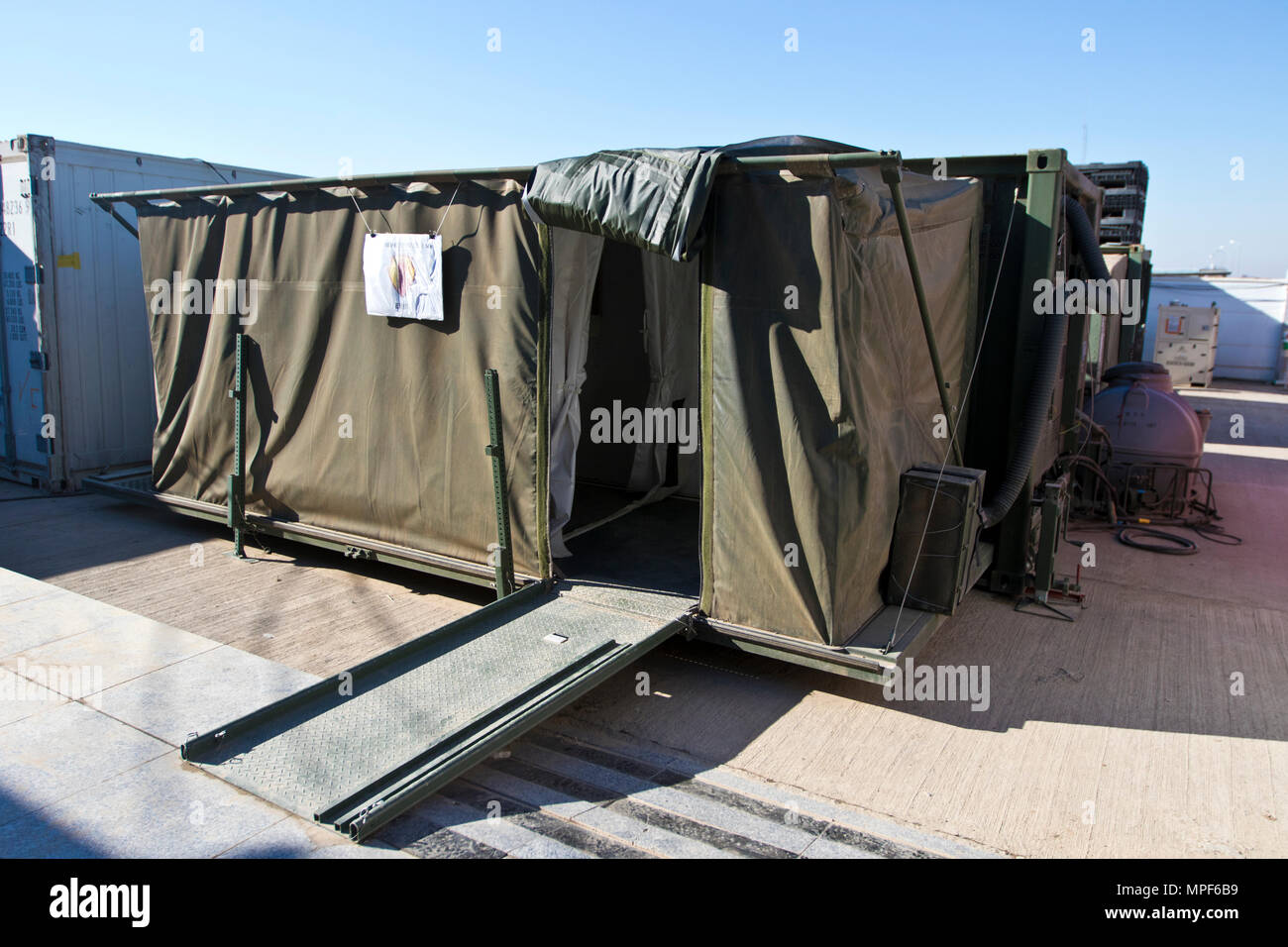 The Mobile Integrated Remains Collections System (MIRCS) is a self-contained shelter with four main areas; receiving and processing area, refrigerated storage area for remains, administrative area and storage for operational supplies. (U.S. Army photo by Staff Sgt. Dalton Smith) - Stock Image