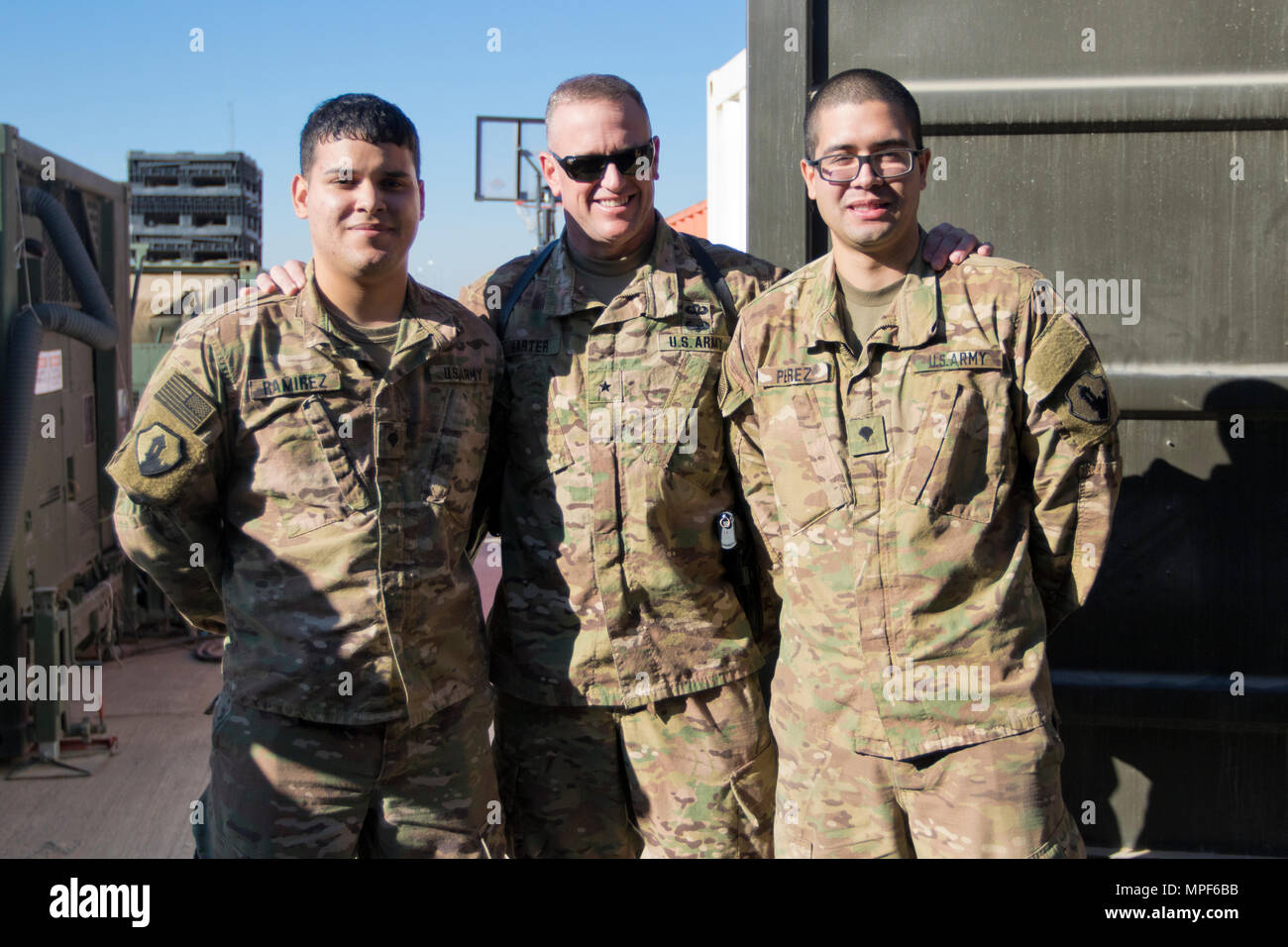 Brig. Gen. Robert D. Harter, deputy commanding general of the 1st Sustainment Command (Theater) / commanding general of the 316th Sustainment Command (Expeditionary), (center), poses with Spc. Brian Ramirez, (left), and Spc. Jose Perez, (right), both mortuary affairs specialists with the 246th Quartermaster Company (Mortuary Affairs), an U.S. Army Reserve unit based out of Mayaguez, Puerto Rico, in Erbil, Iraq on February 3, 2017. (U.S. Army photo by Staff Sgt. Dalton Smith) - Stock Image
