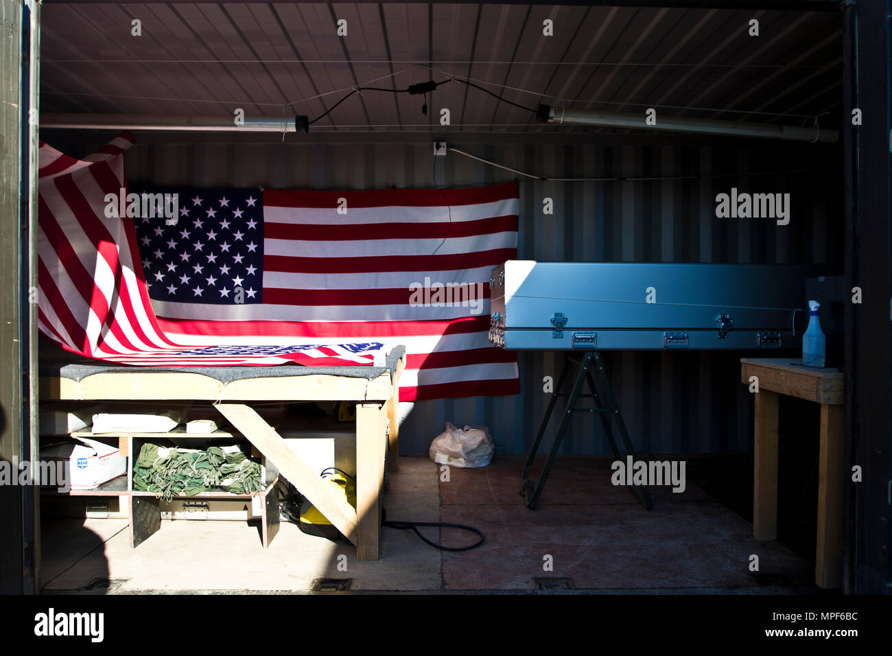 This is a container that includes a steamer and iron for removing wrinkles in flags, a rope system that can drape flags over top a transfer cases (casket) and a transfer case owned and operated by the 246th Quartermaster Company (Mortuary Affairs), in Erbil, Iraq on February 3, 2017. (U.S. Army photo by Staff Sgt. Dalton Smith) - Stock Image