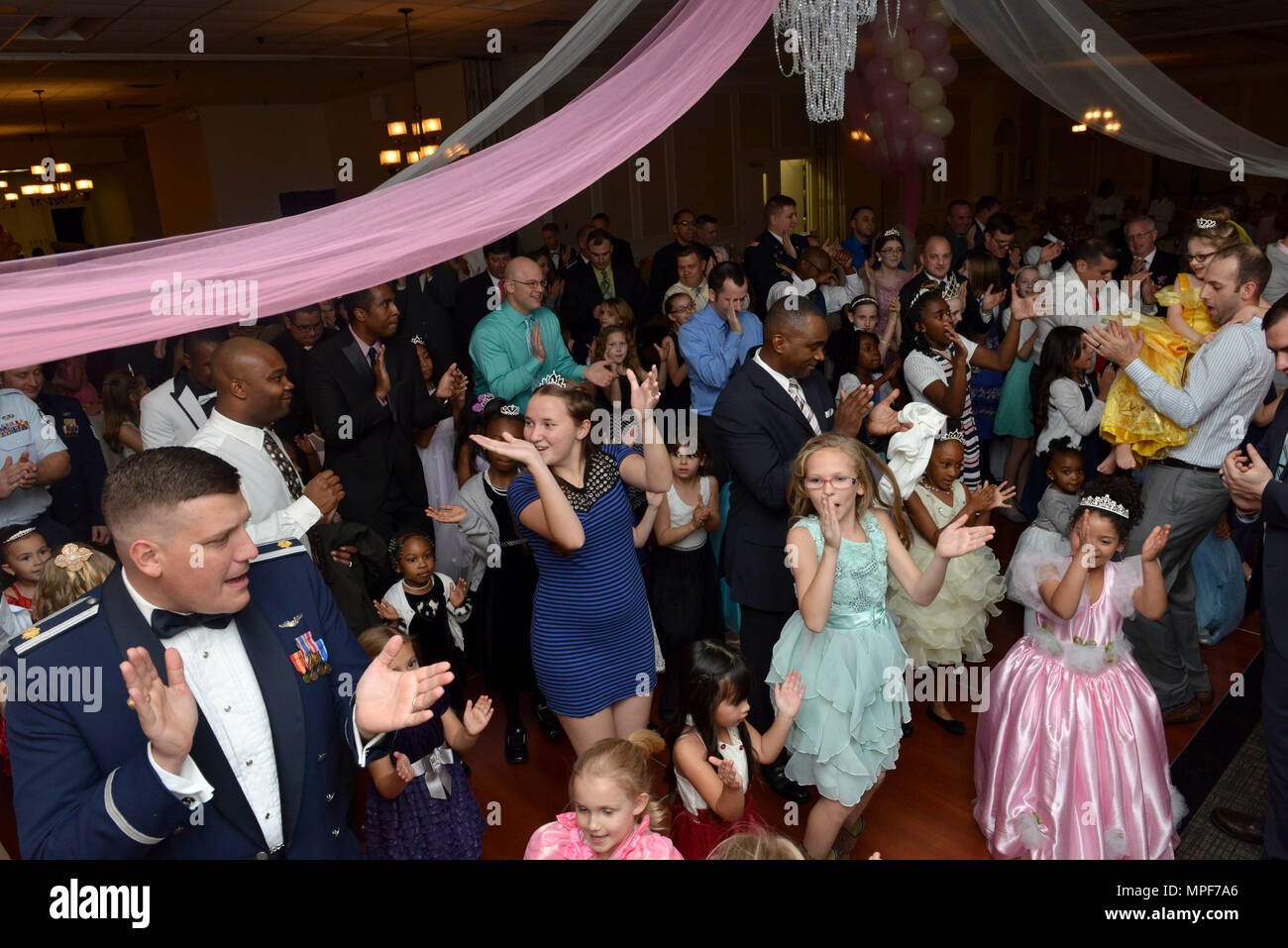 """3d1beed5b Team Shaw members clap their hands while dancing during a """"Royal Affair""""  father-daughter princess ball ..."""