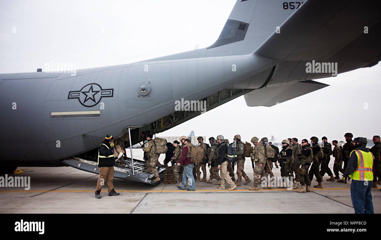 Passengers load onto a C-130J Hercules at Bagram Airfield, Afghanistan, Feb. 17, 2017. The 774th EAS uses the unique versatility of the C-130 to provide tactical airlift capabilities in and out of austere locations under atypical conditions. (U.S. Air Force photo by Staff Sgt. Katherine Spessa) - Stock Image