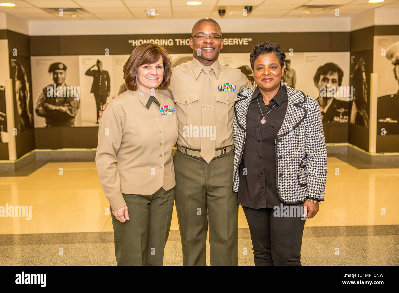 From left, U.S. Marine Corps Col. Cheryl Blackstone, deputy director, G-10 Force Preservation; Col. David D. Scott, real estate analysis, Marine Corps Installations Command and Deanna Scott pose for a photo after Scott's promotion ceremony at the Pentagon, Arlington, Va. on Feb. 17, 2017. Scott was promoted from the rank of Lt. Col. to Col. (U.S. Marine Corps photo by Lance Cpl. Paul A. Ochoa) Stock Photo