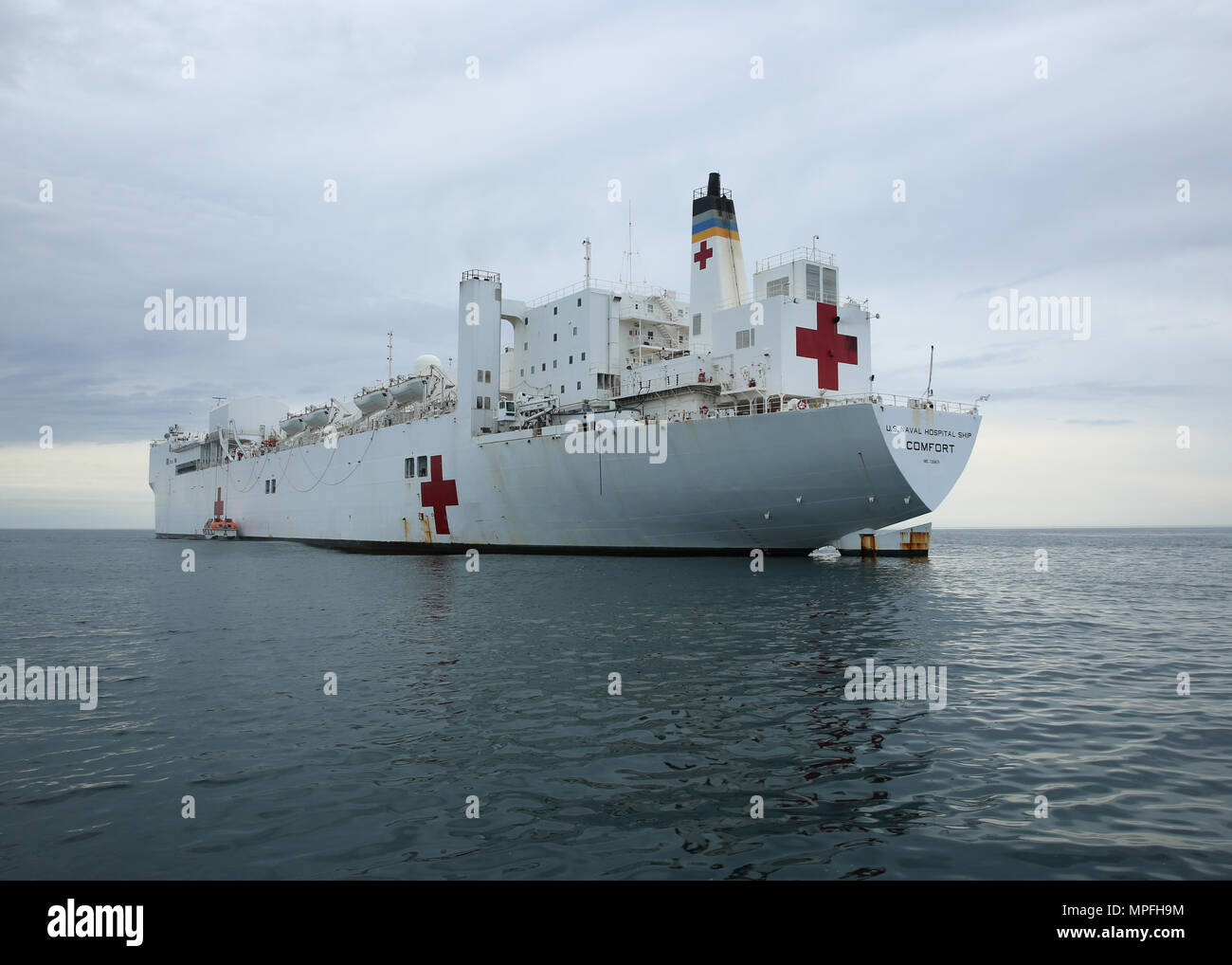 170223-N-OH262-690  ATLANTIC OCEAN (Feb. 23, 2017) The Military Sealift Command hospital ship USNS Comfort (T-AH 20) lowers its tender in the Atlantic Ocean. Comfort's underway period is part of the 2017 Comfort Exercise (COMFEX). The exercise is a quarterly training battery designed to keep the medical personnel, support staff and civil service mariners who serve aboard the ship proficient in their duties. Comfort provides an afloat, mobile, acute surgical medical facility when called upon to the U.S. military, and hospital services to support U.S. disaster relief and humanitarian operations  - Stock Image