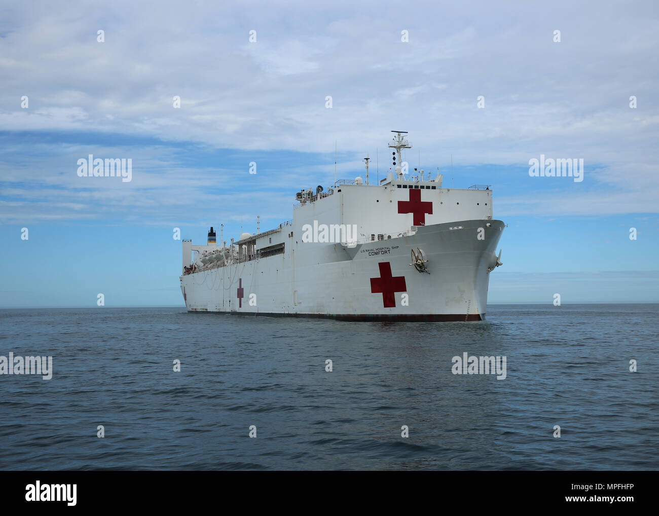 170223-N-OH262-740  ATLANTIC OCEAN (Feb. 23, 2017) The Military Sealift Command hospital ship USNS Comfort (T-AH 20) transits the Atlantic Ocean. Comfort's underway period was part of the 2017 Comfort Exercise (COMFEX). The exercise is a quarterly training battery designed to keep the medical personnel, support staff and civil service mariners who serve aboard the ship proficient in their duties. Comfort provides an afloat, mobile, acute surgical medical facility when called upon to the U.S. military, and hospital services to support U.S. disaster relief and humanitarian operations worldwide.  - Stock Image