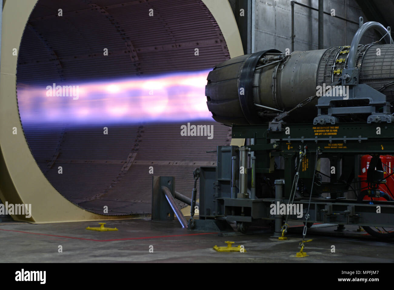 An F-16CM Fighting Falcon engine runs at a test cell facility at