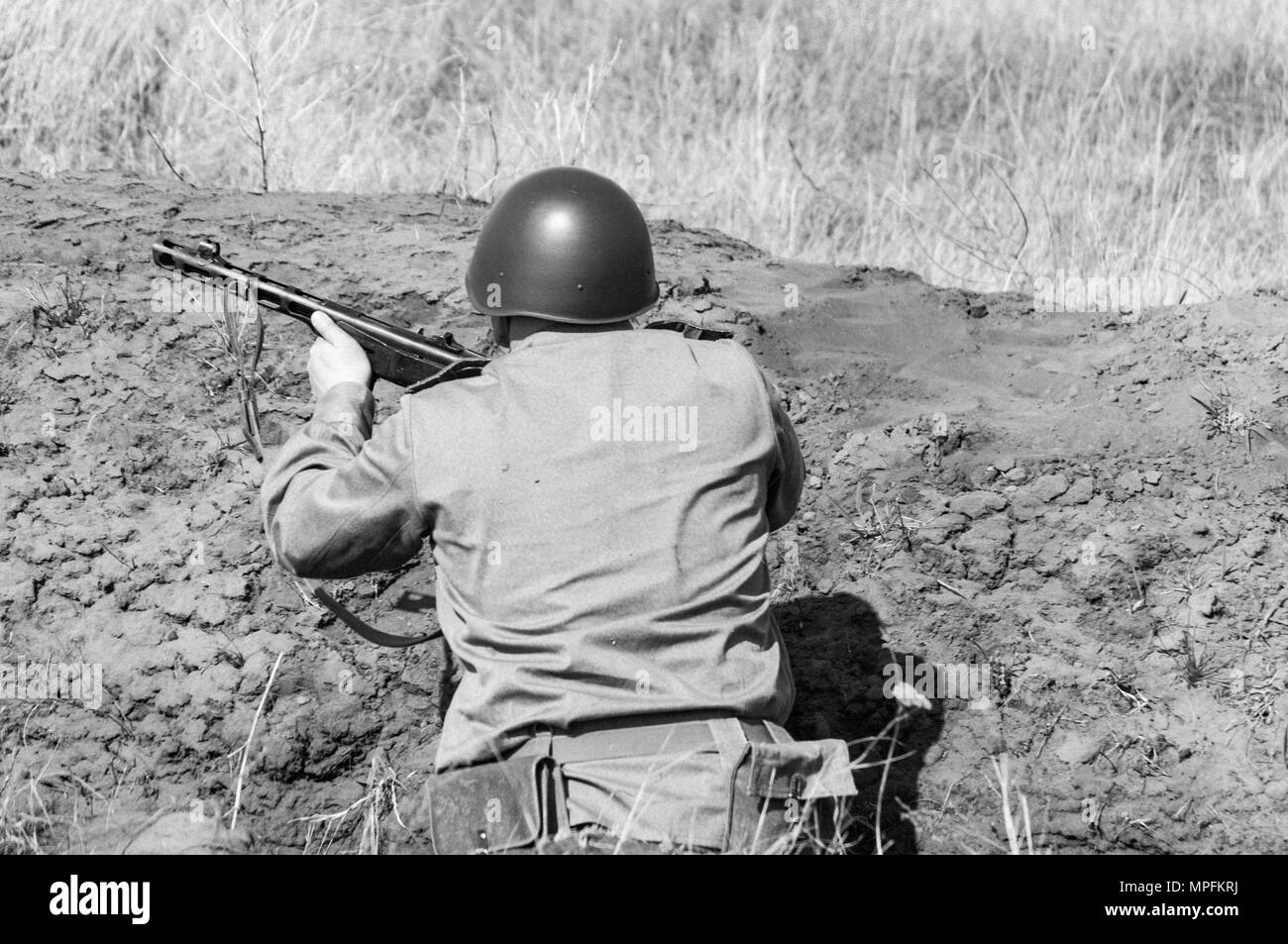 2018-04-30 The Samara Region, Russia. Soviet soldiers in the trenches. Reconstruction of military operations. - Stock Image