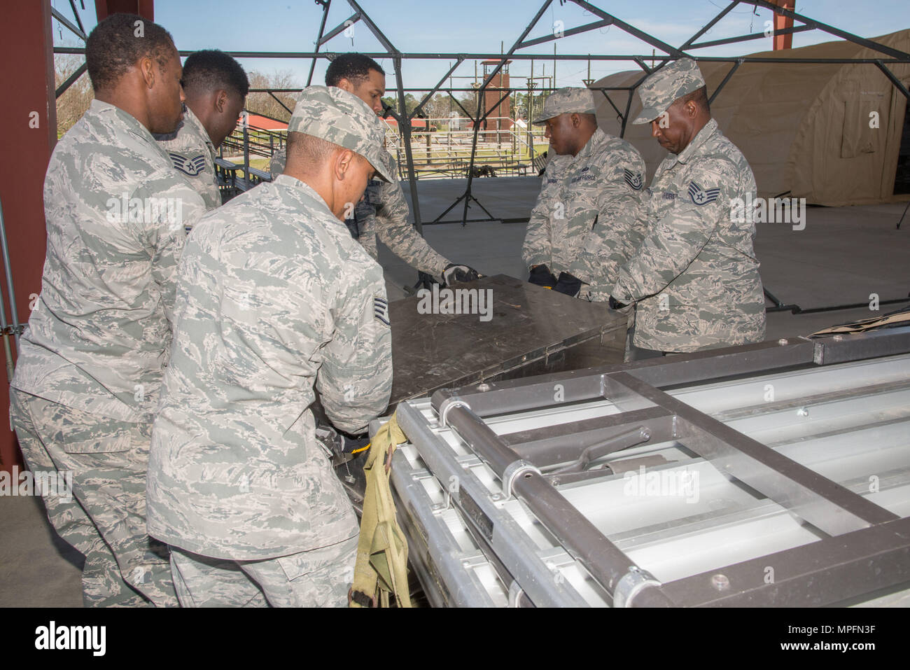 Maxwell AFB,  Ala. - Members of the 908th Airlift Wing practice for an upcoming Single Pallet Expeditionary Kitchen inspection. (US Air Force photo by Trey Ward/Released) - Stock Image