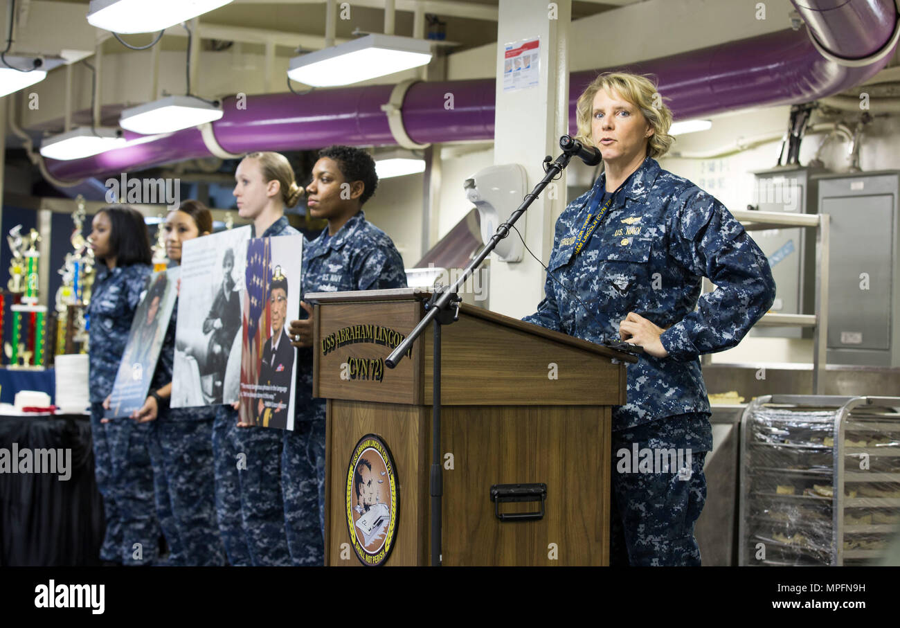 170303-N-SA173-031  NEWPORT NEWS, Va. (March 3, 2017) Capt. Amy Bauernschmidt, executive officer of the Nimitz-class aircraft carrier USS Abraham Lincoln (CVN 72) speaks during the Women's History Month observance on the ship's mess deck. The event honored trailblazing Navy women such as Rear Adm. Grace Hopper, Capt. Sarah Joyner, and Chief Yeoman Loretta Walsh. (U.S. Navy Photo by Mass Communication Specialist 3rd Class Juan Cubano/Released) - Stock Image