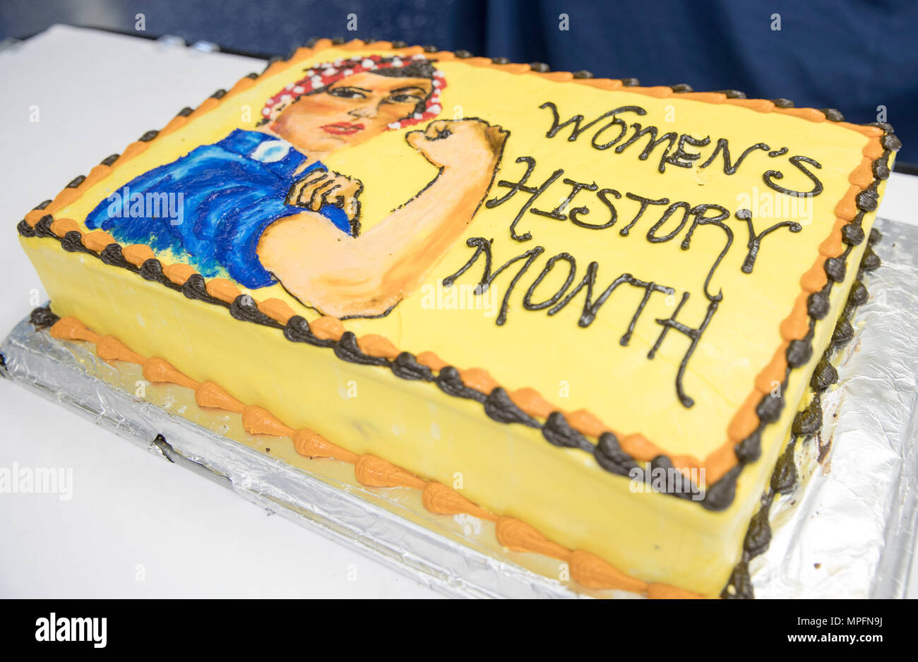 "170303-N-SA173-040  NEWPORT NEWS, Va. (March 3, 2017) A special ""Rosie the Riveter"" cake was created by the bakery shop aboard USS Abraham Lincoln (CVN 72) for the command's Women's History Month observance on the ship's mess deck. The event honored trailblazing Navy women such as Rear Adm. Grace Hopper, Capt. Sarah Joyner, and Chief Yeoman Loretta Walsh. (U.S. Navy Photo by Mass Communication Specialist 3rd Class Juan Cubano/Released) - Stock Image"