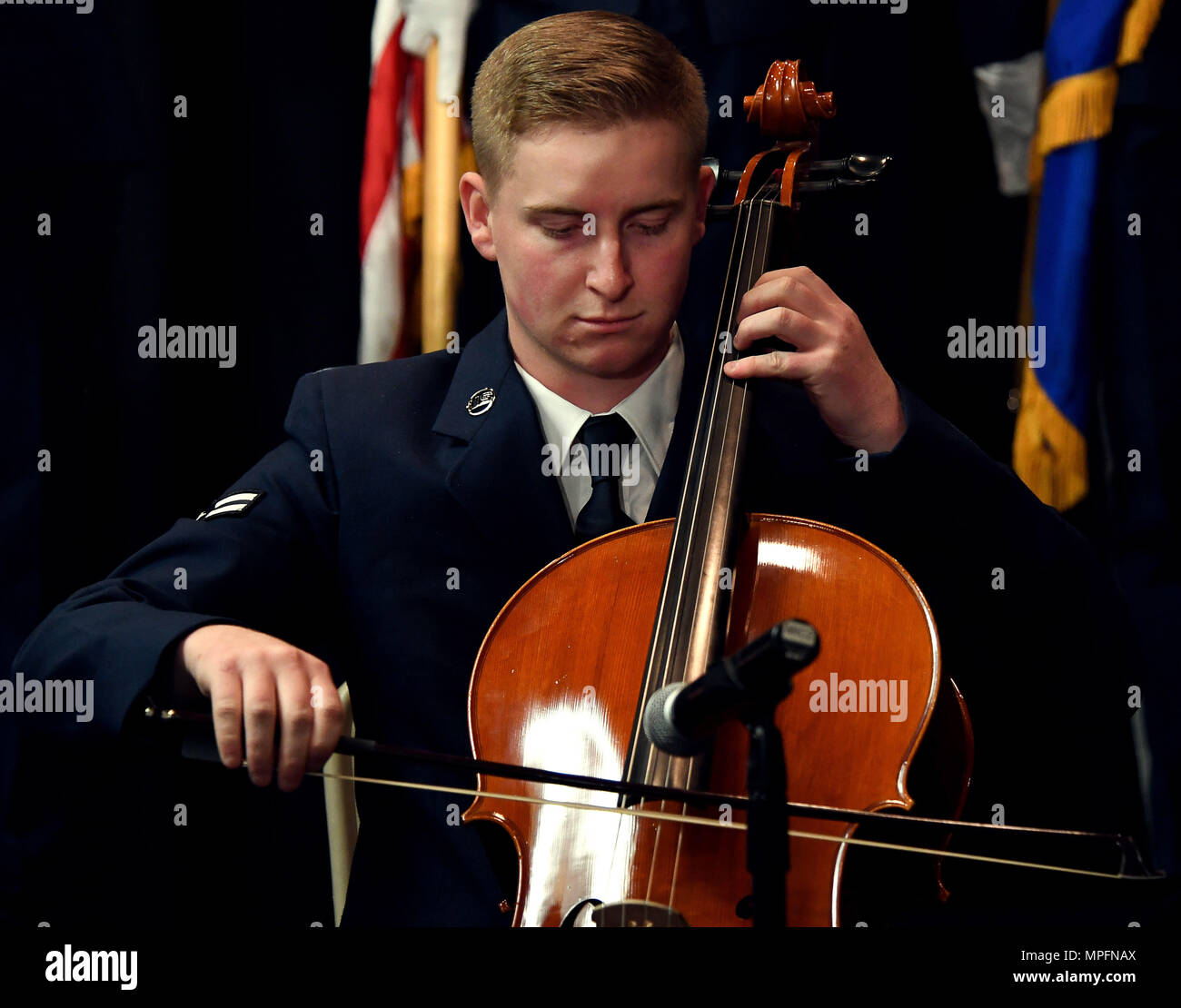 An Airman assigned to the 432nd Wing/432nd Air Expeditionary Wing performs the National Anthem for the 432nd Wing Annual Awards Banquet Feb. 11, 2017, at Nellis Air Force Base, Nev. The ceremony highlighted nominated Airmen and civilians who performed highly in their respected fields. (U.S. Air Force photo/Airman 1st Class James Thompson) - Stock Image