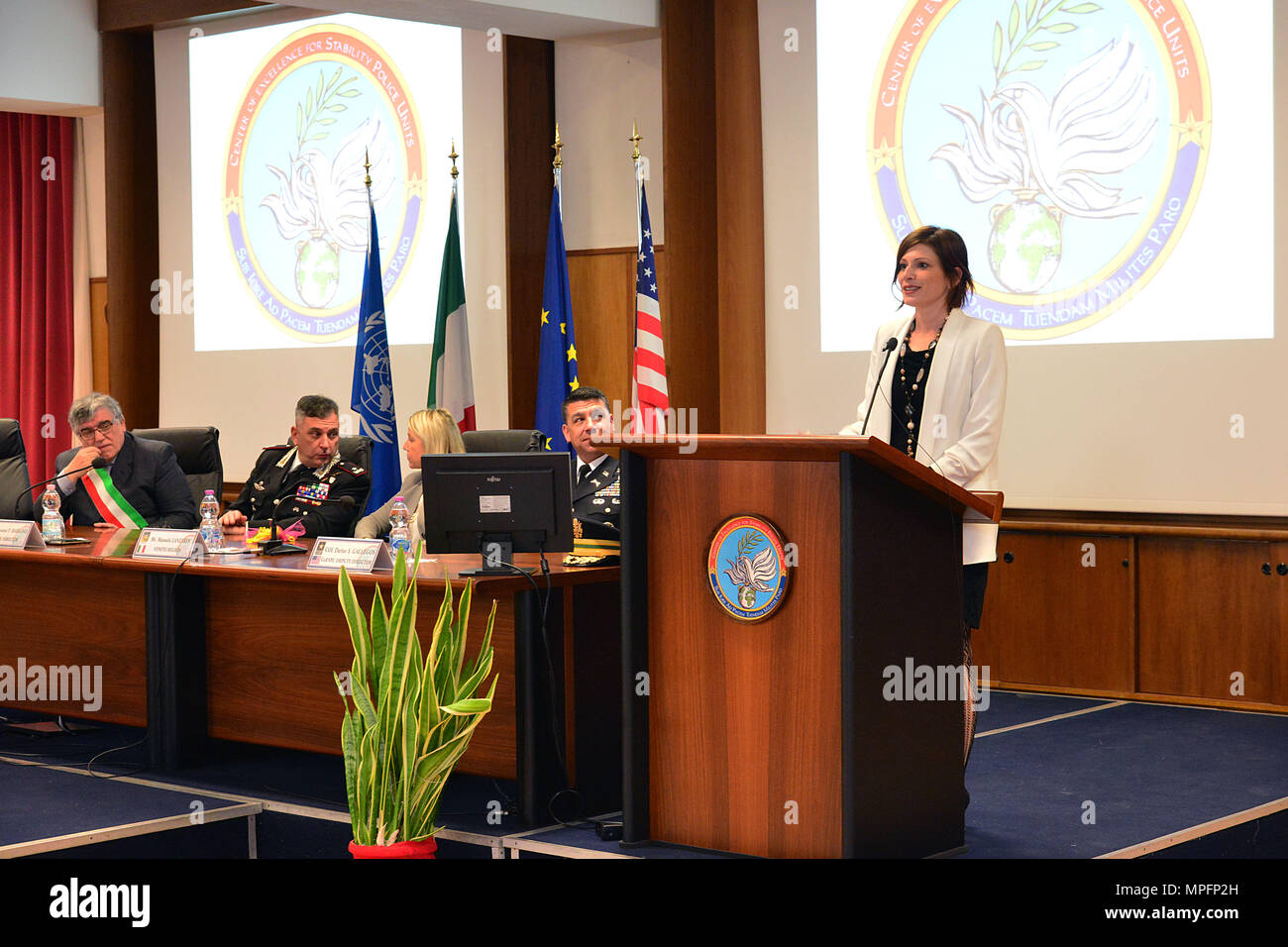 """Dr. Irene Fellin, Gender Consultant International Affairs Institute Roma, Italy, addresses attendees at the opening ceremony of the 5th """"Gender Protection in Peace Operations"""" Course at the  Center of Excellence for Stability Police Units (CoESPU) in Vicenza, Italy, Mar. 8, 2017. The event brought together military and civic leaders of the local community and offered the opportunity to celebrate International Women's Day. (U.S. Army Photo by Visual Information Specialist Paolo Bovo/released) - Stock Image"""
