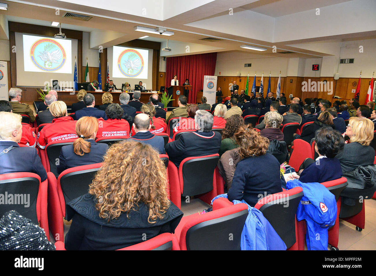 """Dr. Irene Fellin, Gender Consultant International Affairs Institute Roma, Italy , addresses attendees at the opening ceremony of the 5th """"Gender Protection in Peace Operations"""" Course at the  Center of Excellence for Stability Police Units (CoESPU) in Vicenza, Italy, Mar. 8, 2017. The event brought together military and civic leaders of the local community and offered the opportunity to celebrate International Women's Day. (U.S. Army Photo by Visual Information Specialist Paolo Bovo/released) - Stock Image"""