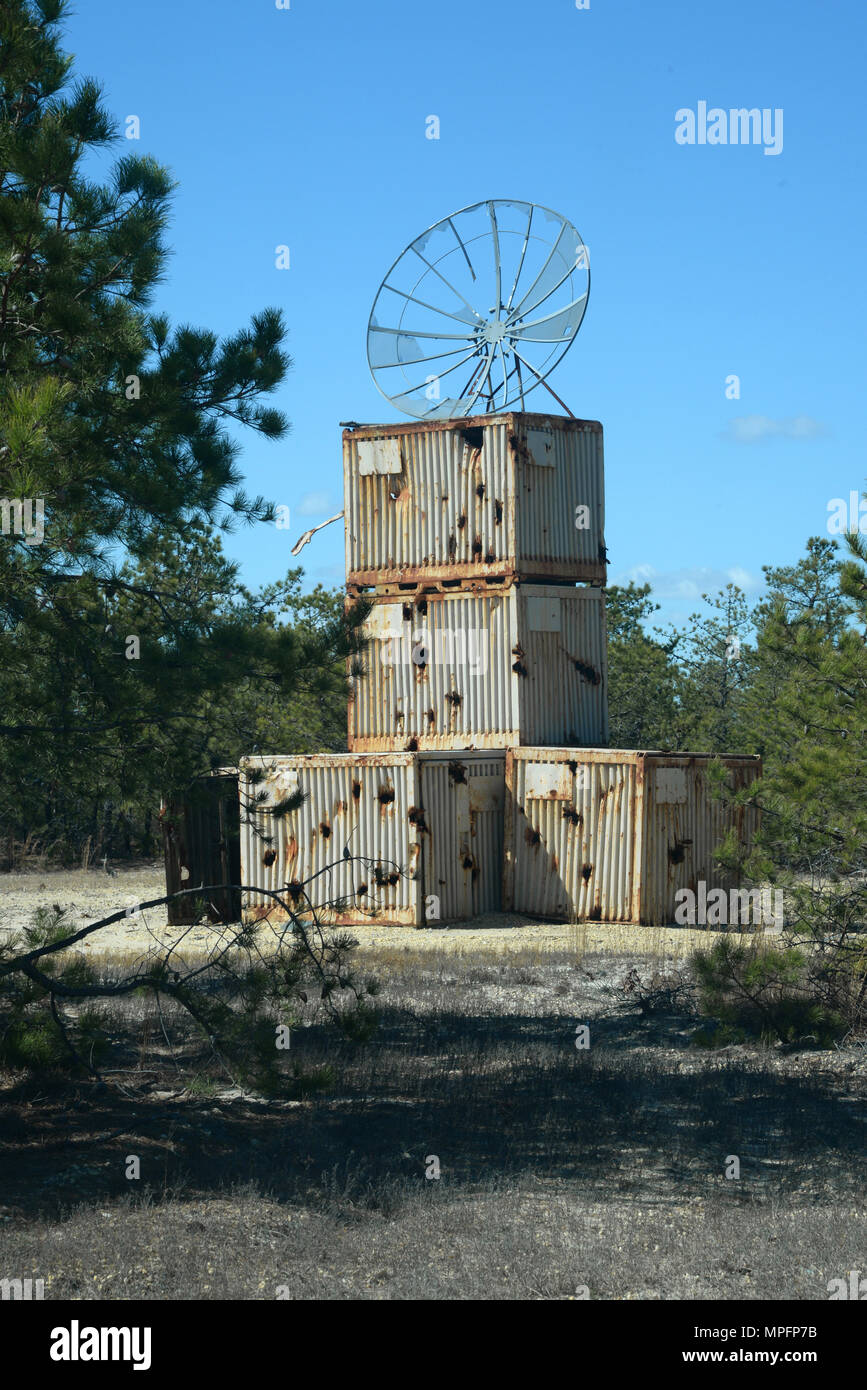A simulated radar tower made of storage containers is used for a
