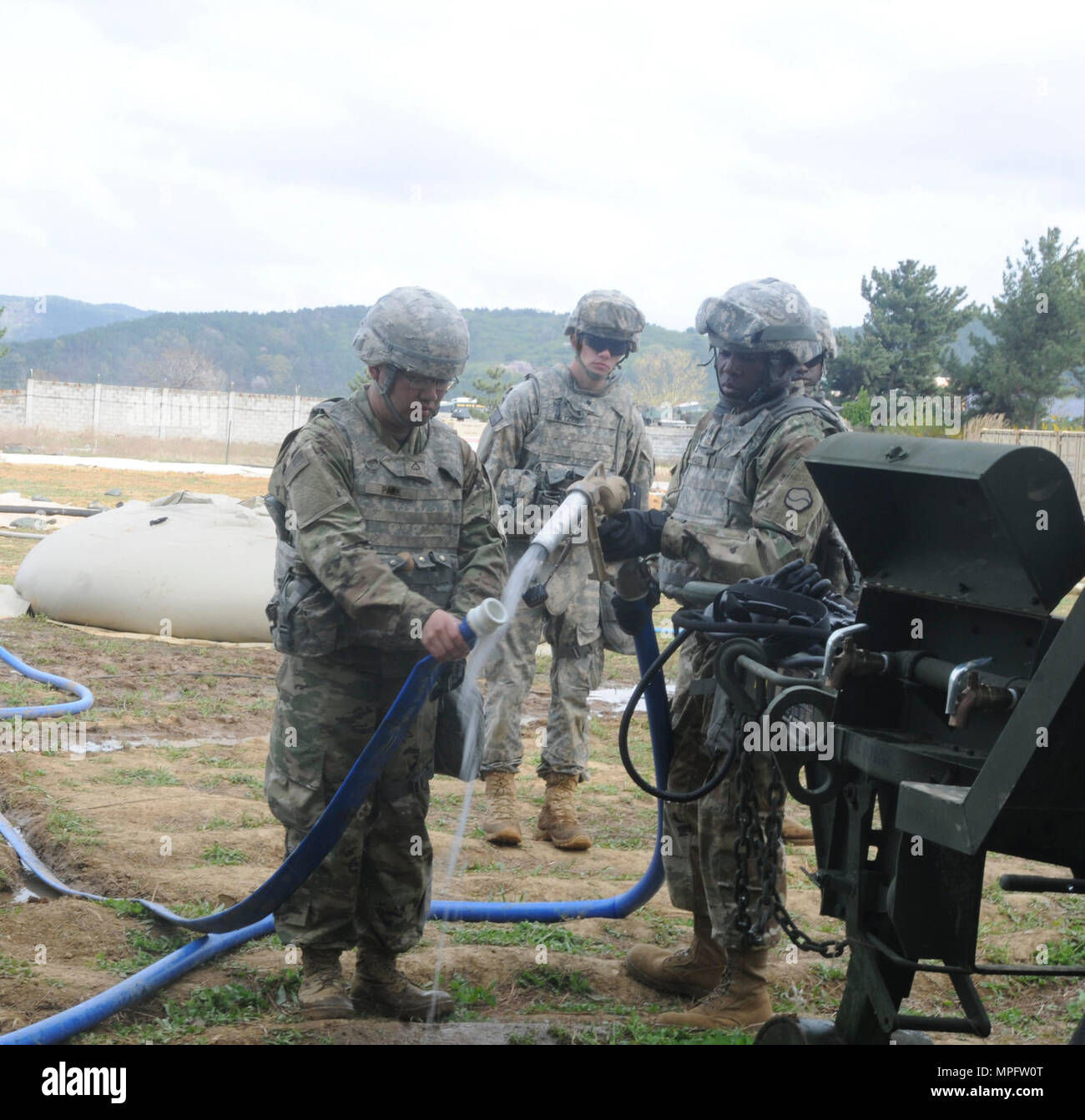 Soldiers assigned to 339th Quartermaster Company sanitizes a