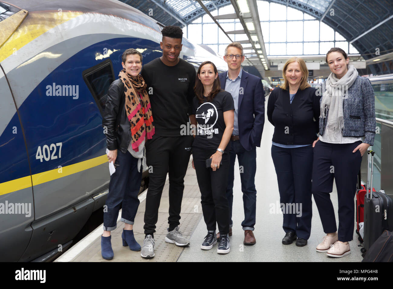 St Pancras, UK. 23rd May 2018. Ky Lewis, Winner of Gigs Eurostar prize poses with the Busking London team before he boards the train to Amsterdam. He set off on a whirlwind busking tour of Amsterdam. He will serenade passengers on the train as they travel under the Channel and complete the day busking in Amsterdam.Credit Keith Larby/Alamy Live News - Stock Image