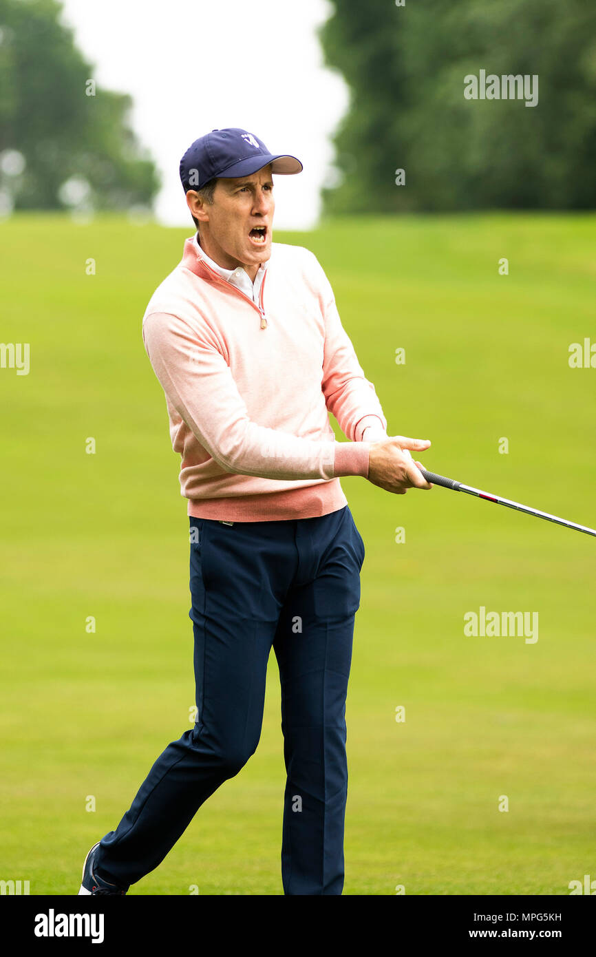 Wentworth Club, Virginia Water, UK. 23rd May, 2018. BMW PGA Championship at Wentworth, Pro AM day; Anton Du Beke urges his ball towards the fourth green Credit: Action Plus Sports/Alamy Live News - Stock Image