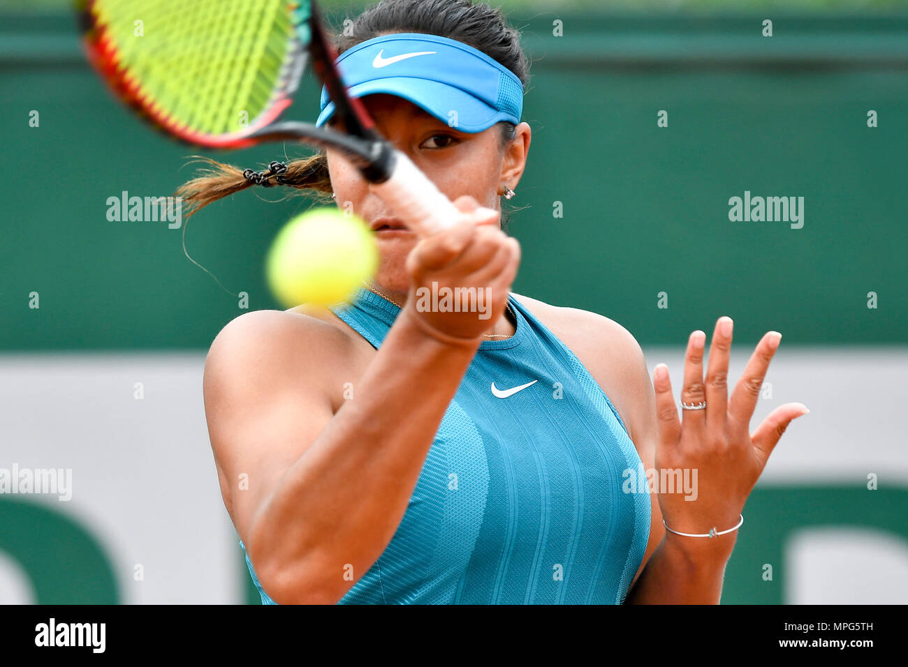 Paris, France. 23rd May, 2018. Destanee Aiava of Australia returns the ball to Liu Fangzhou of China during the women's singles Qualification 1st round match of French Open in Paris, France on May 23, 2018. Destanee Aiava lost 1-2. Credit: Chen Yichen/Xinhua/Alamy Live News Stock Photo