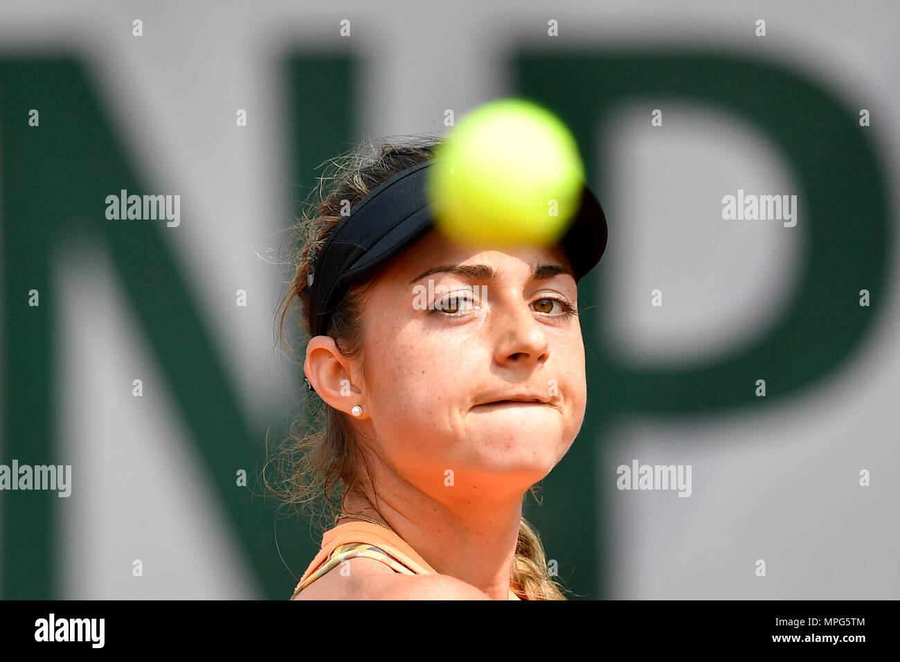 Paris, France. 23rd May, 2018. Margot Yerolymos of France eyes on the ball during the women's singles Qualification 1st round match of French Open against Lu Jiajing of China in Paris, France on May 23, 2018. Margot Yerolymos won 2-0. Credit: Chen Yichen/Xinhua/Alamy Live News Stock Photo