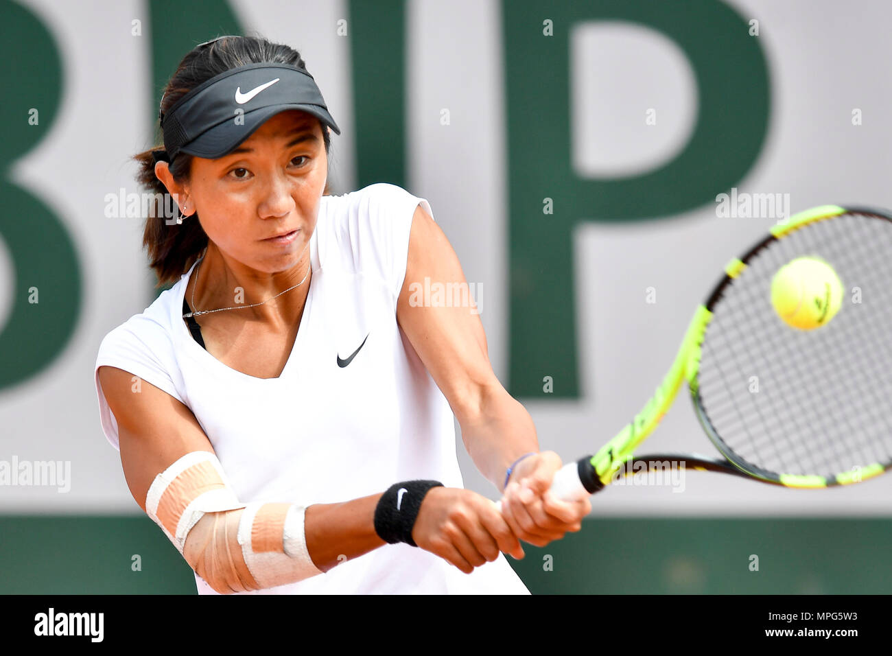 Paris, France. 23rd May, 2018. Lu Jiajing of China returns the ball to Margot Yerolymos of France during the women's singles Qualification 1st round match of French Open in Paris, France on May 23, 2018. Lu lost 0-2. Credit: Chen Yichen/Xinhua/Alamy Live News Stock Photo