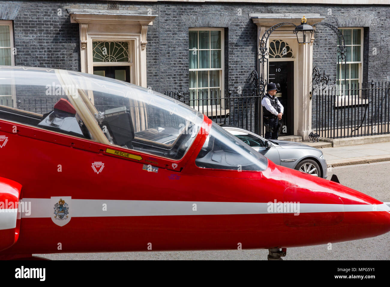 Downing Street, London, UK. 23rd May, 2018. A Red Arrow jet parked outside Number 10 Downing St, London, UK, to mark 100 years of the RAF (Royal Air Force) MUST CREDIT: Chris Aubrey/Alamy Live News Stock Photo