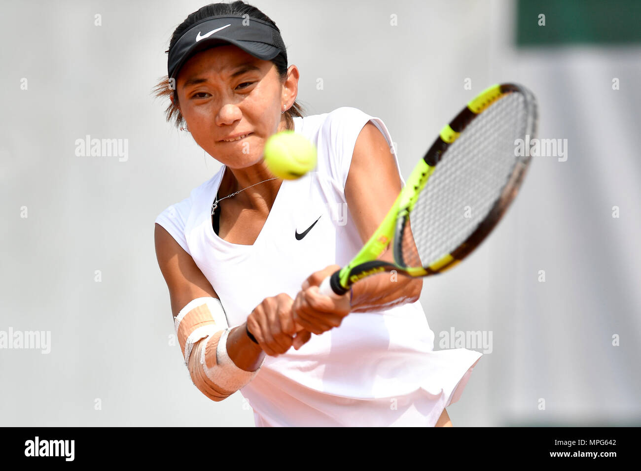 Paris. 23rd May, 2018. Lu Jiajing of China returns the ball to Margot Yerolymos of France during the women's singles Qualification 1st round match of French Open in Paris, France on May 23, 2018. Lu lost 0-2. Credit: Chen Yichen/Xinhua/Alamy Live News Stock Photo