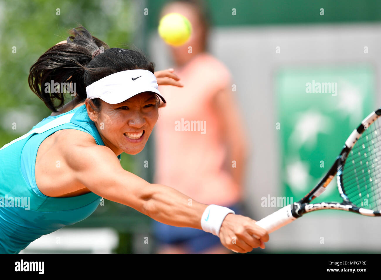 Paris. 23rd May, 2018. Lu Jingjing of China returns the ball to Gabriella Taylor of Britain during the women's singles Qualification 1st round match of French Open in Paris, France on May 23, 2018. Lu lost 0-2. Credit: Chen Yichen/Xinhua/Alamy Live News Stock Photo