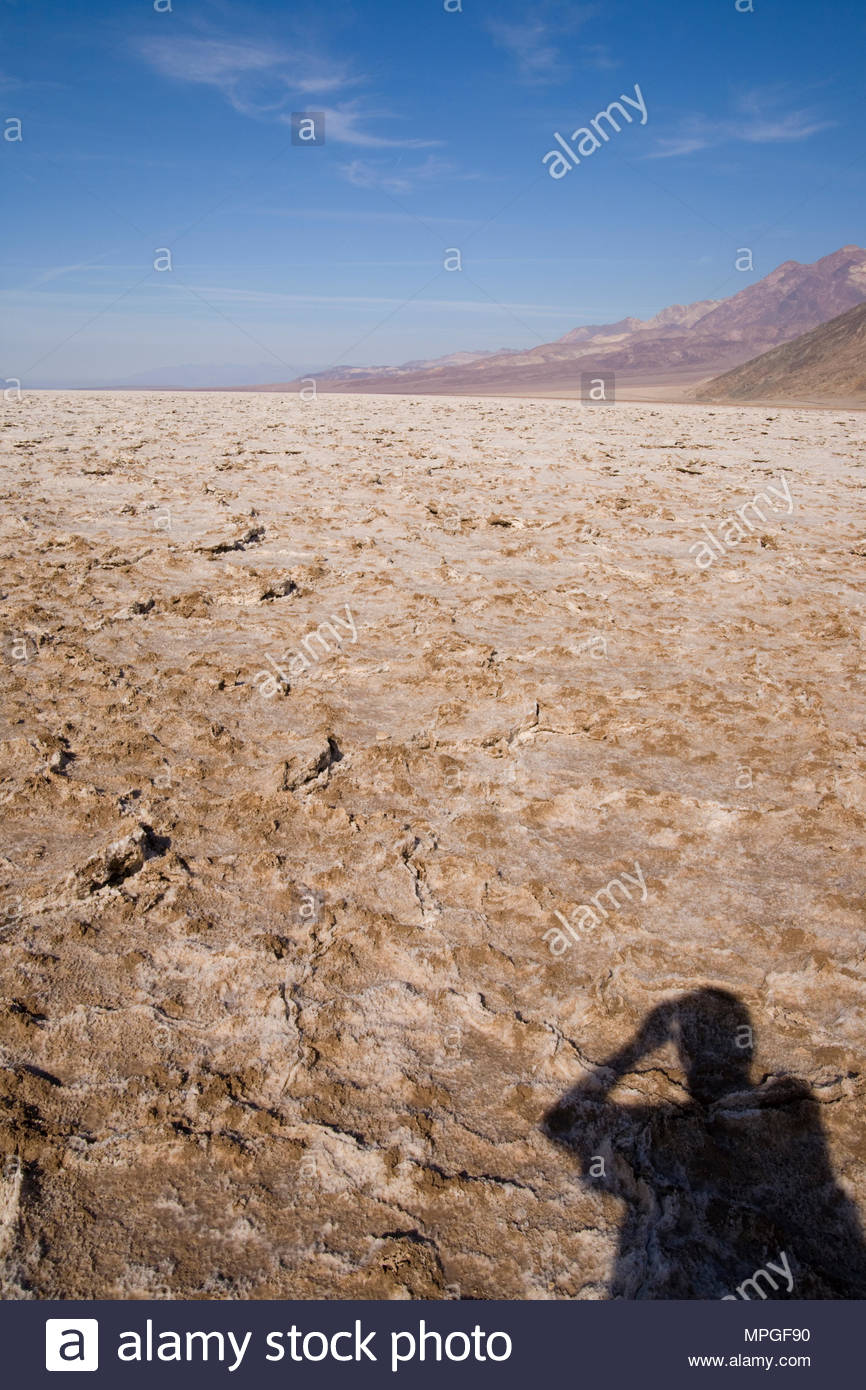 Shadow of person taking picture of Bad Water Basin, Death Valley National Park, California, USA - Stock Image
