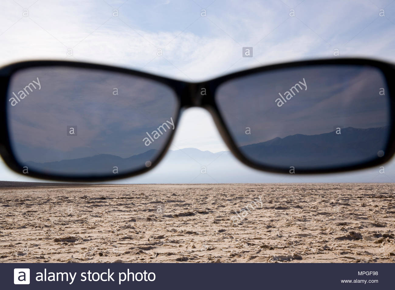 Polarized sun glasses view of Bad Water Basin, Death Valley National Park, California USA - Stock Image