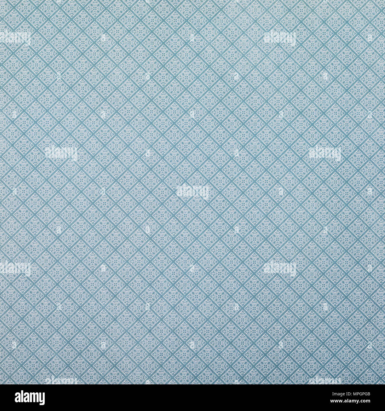 blue wrapper design with white lozenges pattern - Stock Image
