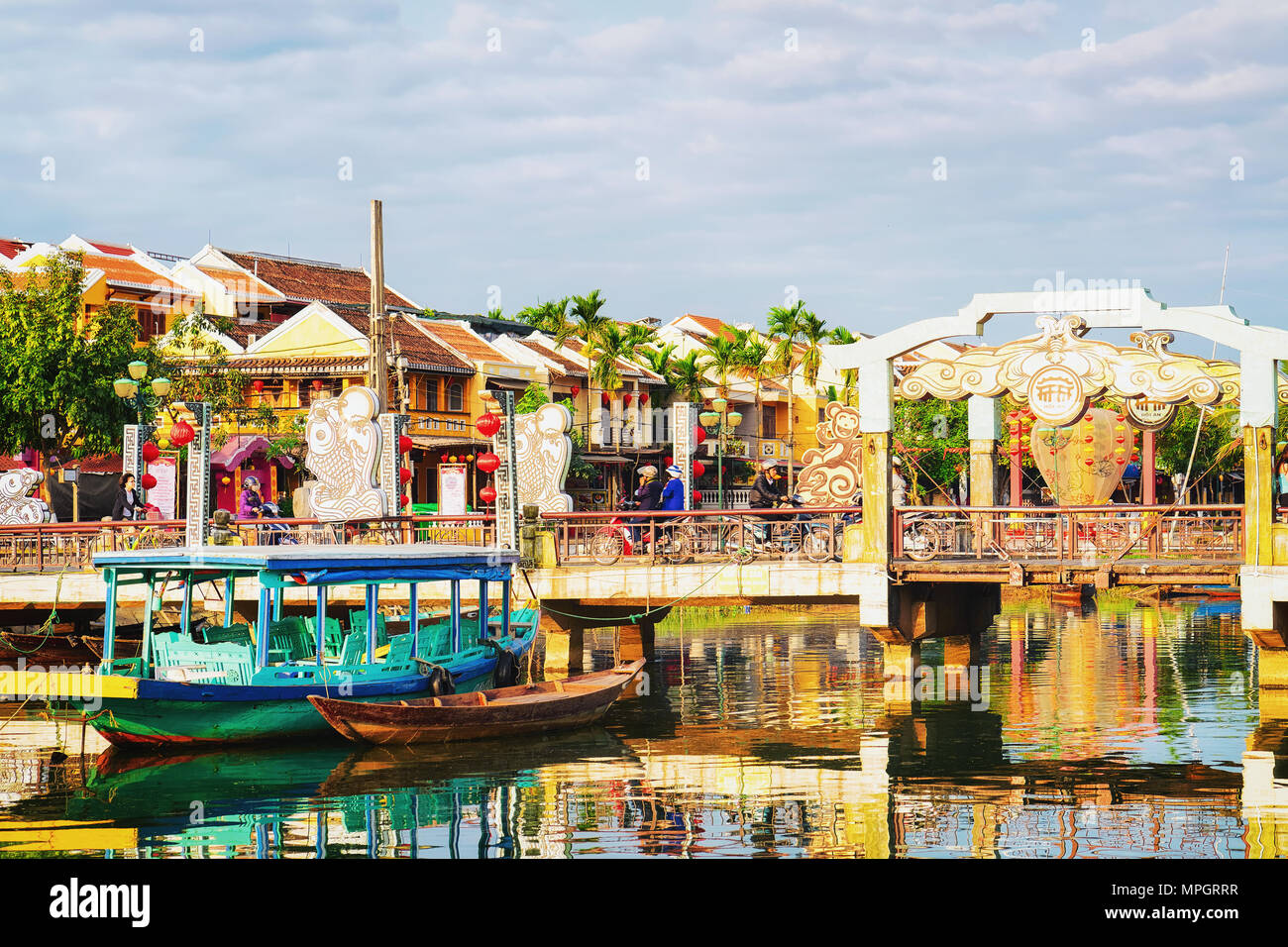 Hoi An, Vietnam - February 17, 2016: Boat at the Embankment of Thu Bon River, Hoi An, Vietnam Stock Photo