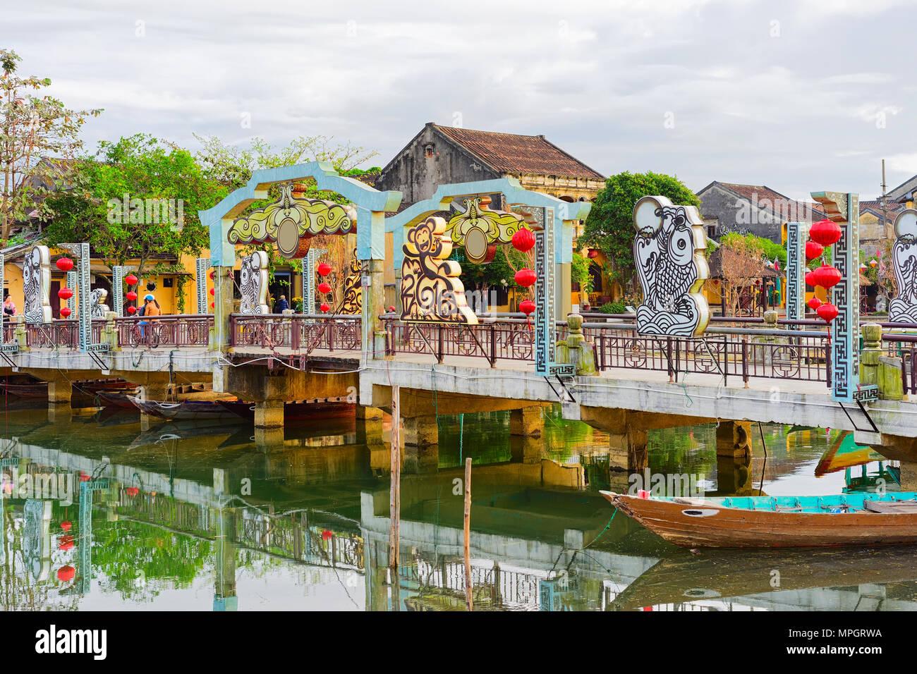 Hoi An, Vietnam - February 17, 2016: Boat near the Embankment of Thu Bon River, Hoi An, Vietnam Stock Photo