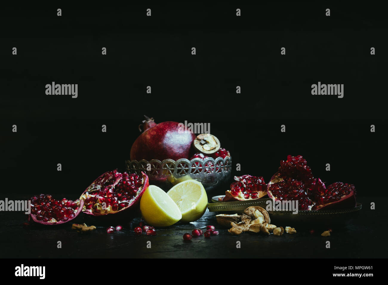 Pomegranates and lemons - Stock Image