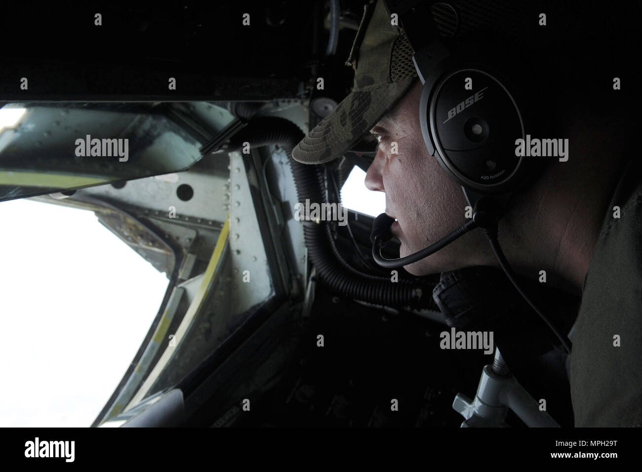 U.S. Air Force Master Sgt. Joshua Welch, 434th Air Refueling Wing boom operator, guides a U.S. Air Force KC-135 Stratotanker boom in place in order to refuel a U.S. Air Force  F-22 Raptor above Royal Australian Air Force Base Tindal, Australia, March 2, 2017. Twelve F-22 Raptors and approximately 200 U.S. Air Force Airmen participated in the first Enhanced Air Cooperation, an initiative under the Force Posture Agreement between the U.S. and Australia. (U.S. Air Force photo by Staff Sgt. Alexander Martinez) - Stock Image