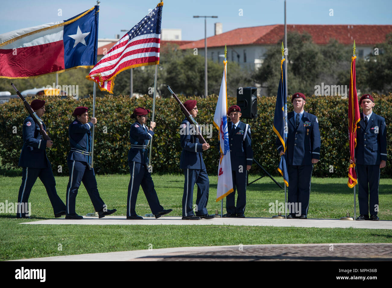 Members of Floresvillie High School Air Force JROTC present the colors at an event honoring Benjamin Foulois March 2, 2017 at Joint Base San Antonio-Fort Sam Houston. Foulois is credited with completing the first military flight in December 1910. (U.S. Air Force photo by Senior Airman Stormy Archer) - Stock Image