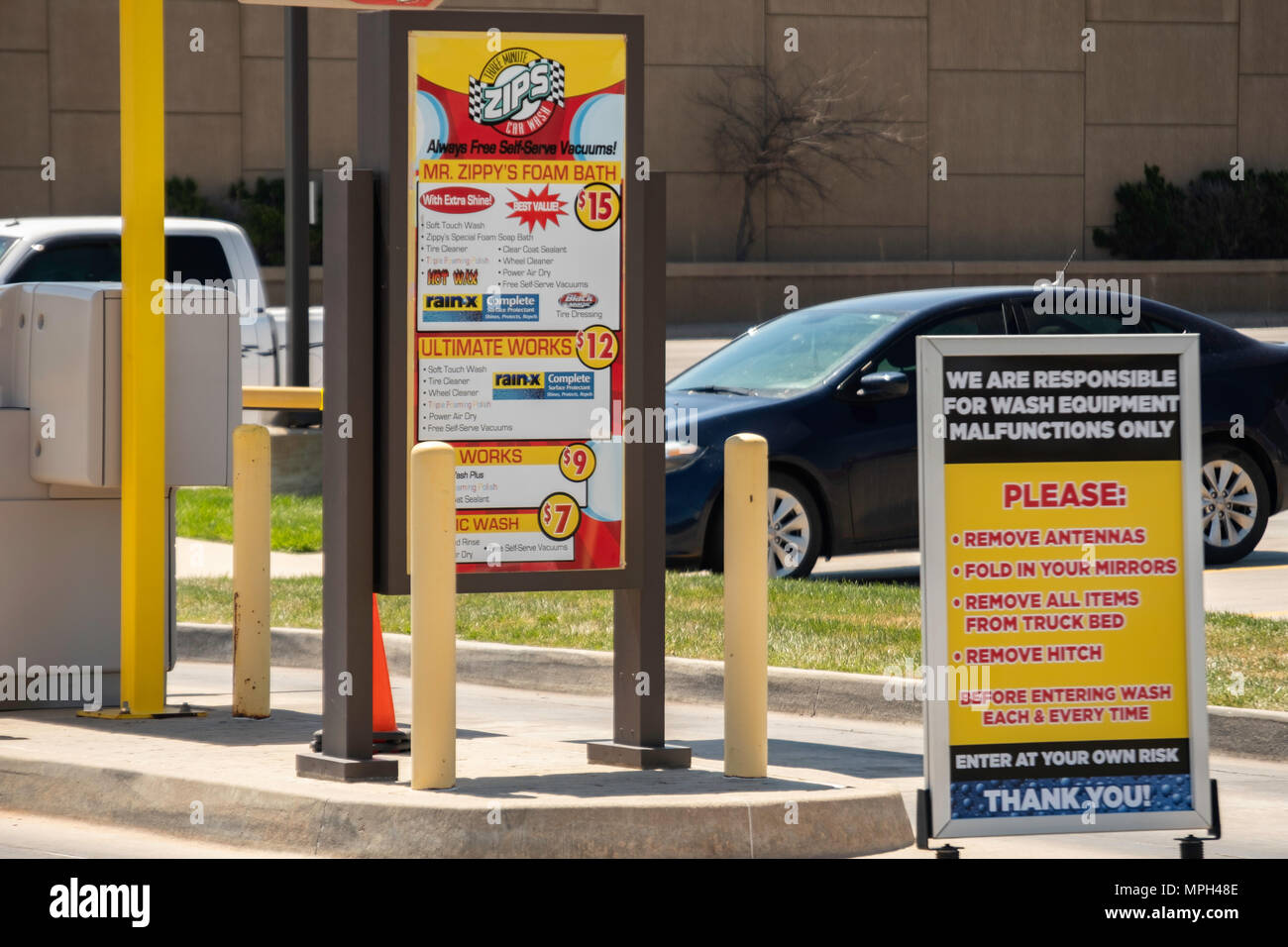 The Signs And Instructions At The Entrance Of A Zips Automatic Car