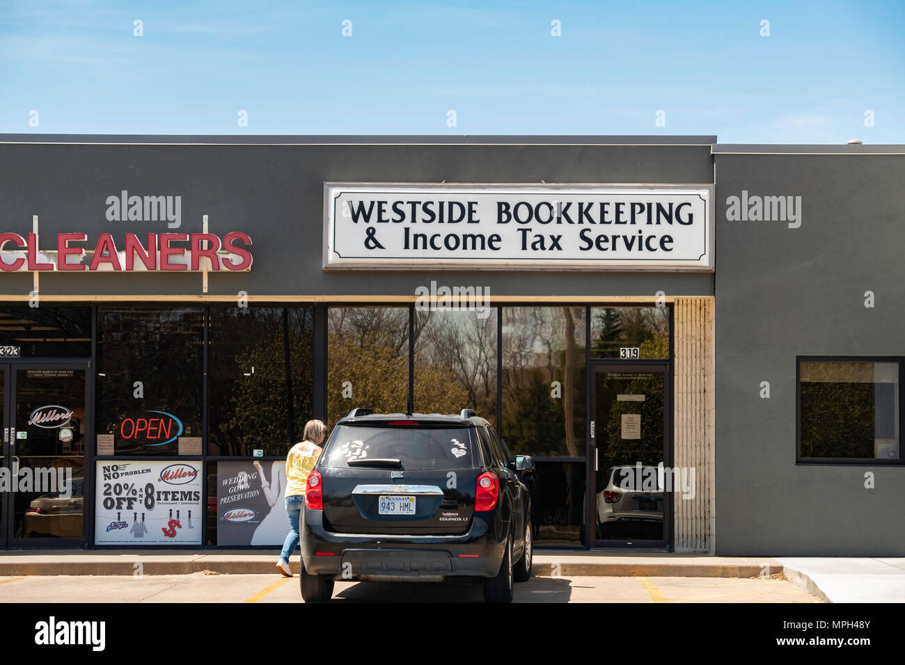 Westside Bookkeeping & Income Tax Service in a strip mall, west side, Wichita, Kansas, USA. - Stock Image