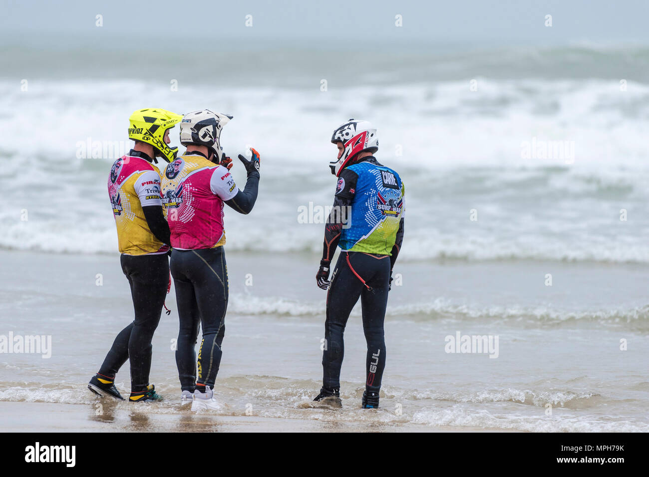 The Freeride World Jetski Championship at Fistral Beach in Newquay, Cornwall.  Competitors discussing tactics. - Stock Image