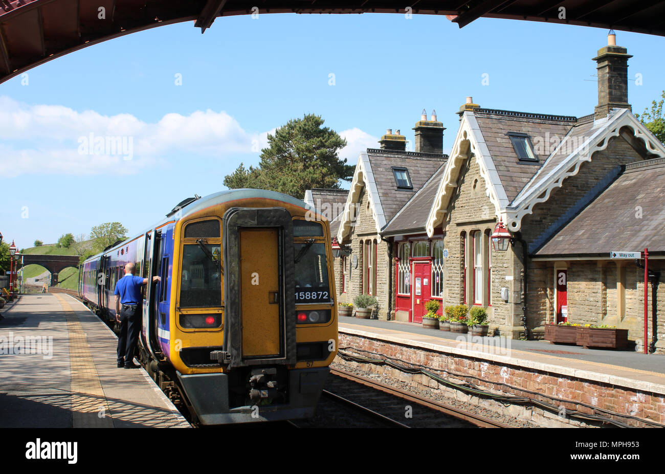 Class 158 diesel multiple unit on a passenger train in Northern livery at Kirkby Stephen station on the Settle to Carlisle railway line. - Stock Image