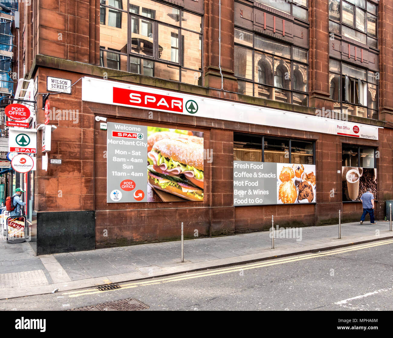 Exterior of the Spar convenience store and post office in the Merchant City area of Glasgow, Scotland, UK - Stock Image