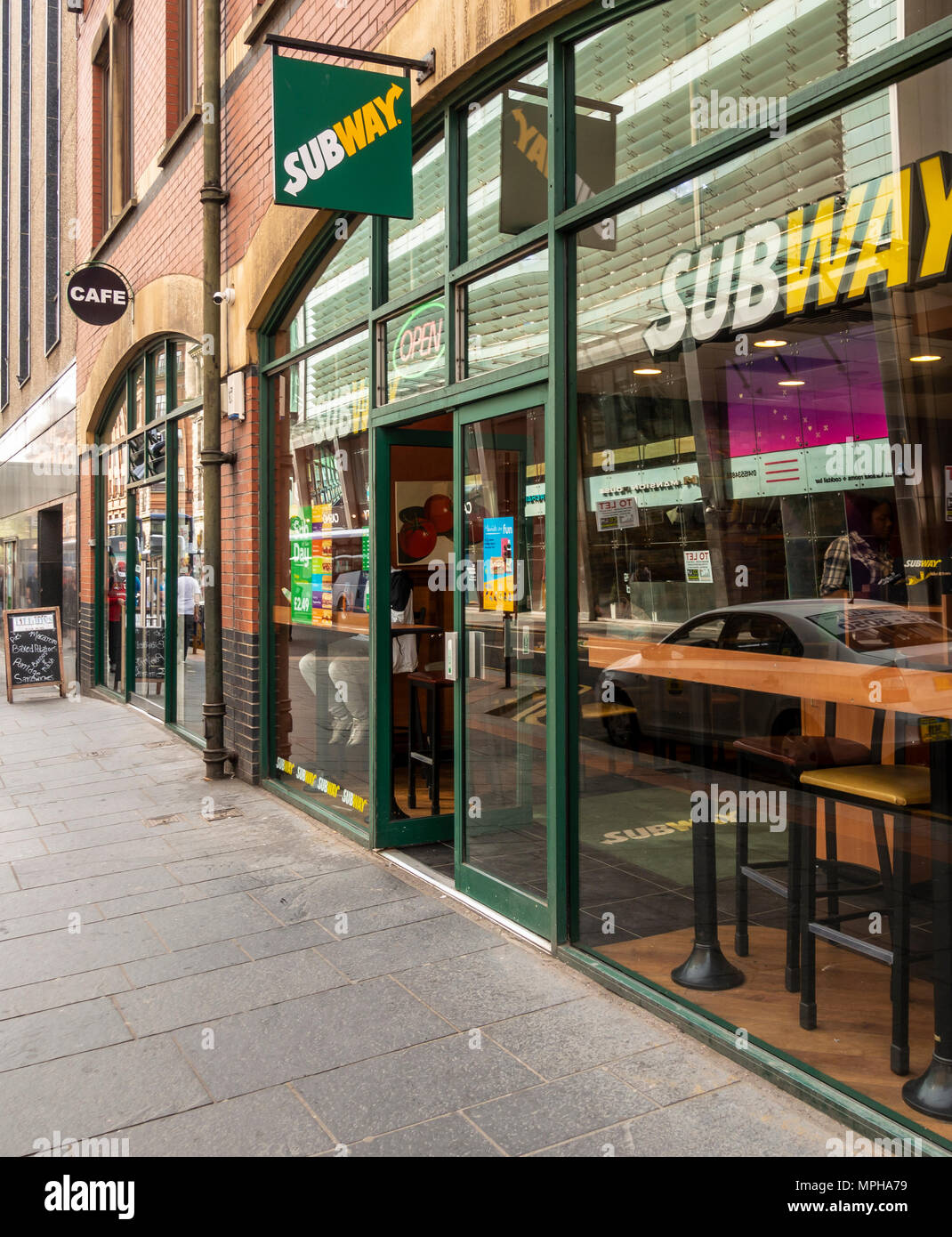 Entrance and window of the Subway Sandwich bar and Tiffany's Cafe, Glassford Street, Merchant City, Glasgow, Scotland, UK - Stock Image
