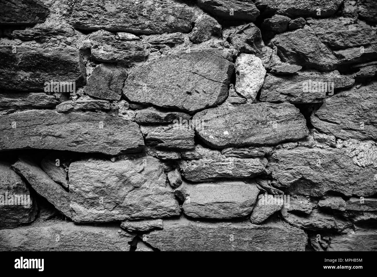 view of old rustic big rocks wall for background copy space for