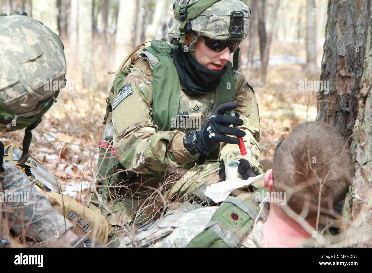 U S  Army Medic Private First Class Luke Albro treats Specialist