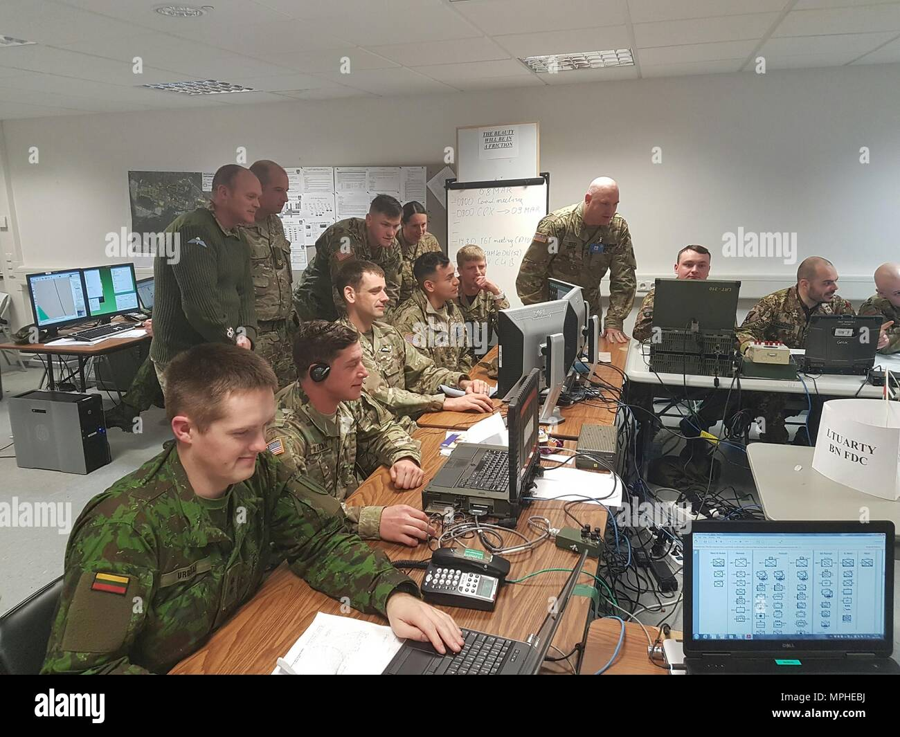 Soldiers of the 2500th and 250th Digital Liaison Detachments work with NATO allies March 10 during the multinational exercise Dynamic Front II in their Tactical Operations Center at Grafenwoehr, Germany. (Photo courtesy 2500th Digital Liaison Detachment) - Stock Image