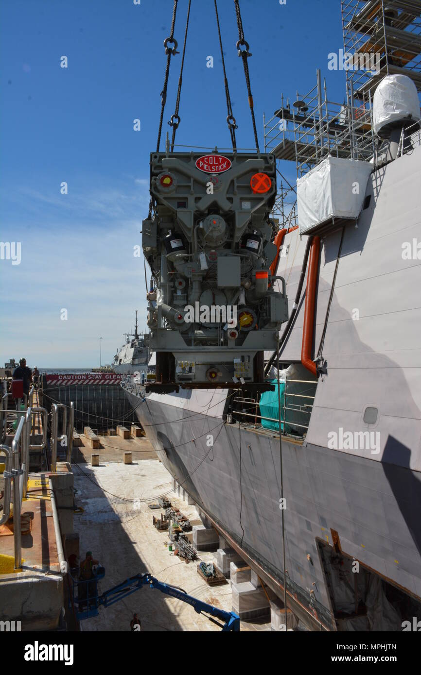 the replacement engine for uss freedom lcs 1 is hoisted into the